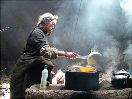 Cooking in a Tibetan nomad tent