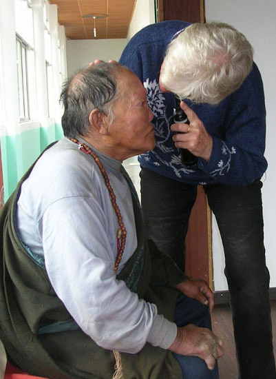Dr. Ray examining the eyes of a local Tibetan patient